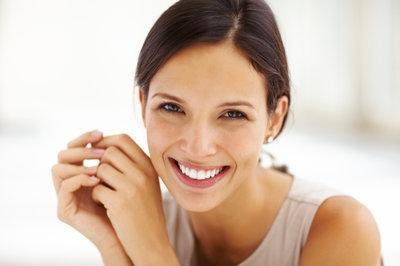 Woman smiling in dental chair | dentist Chesterfield MO