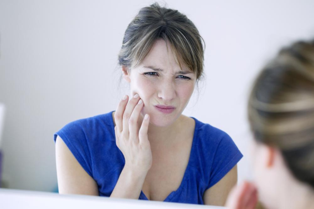 Woman holding jaw from pain