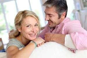 Couple smiling on couch | General Dentistry Chesterfield MO