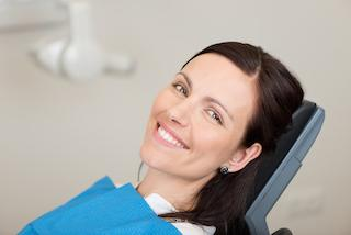 Woman in dental chair smiling | Dentist Chesterfield MO