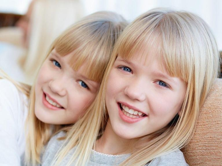 two sisters smiling | family dentist chesterfield mo