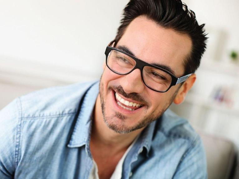 man with glasses smiling | dental implants chesterfield mo