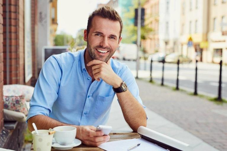 adult man smiling at breakfast | chesterfield valley dental