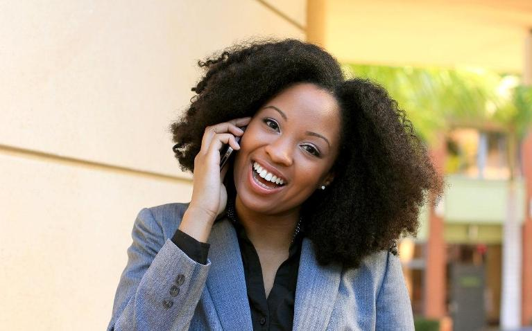 woman on phone smiling | Chesterfield MO Dentist